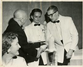 Henry F. Hall Shakes Hands With a Young Man
