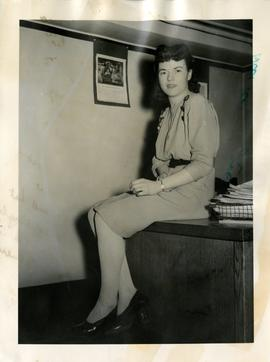 Young Woman Seated on a Desk