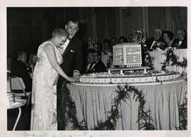 Anna Hall Cuts into a Hall Building cake
