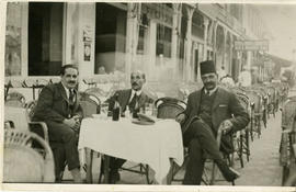 Three Unidentified Men in a Cafe