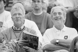 Charles Emond and Frederick Lowy at a football game