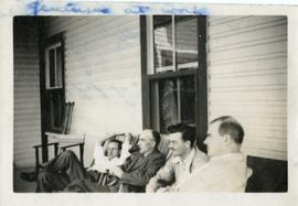 Kenneth E. Norris, Douglass B. Clarke and Two Other Men Sitting on a Porch
