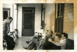 Kenneth E. Norris, Douglass B. Clarke and Three Other Men Sitting on a Porch