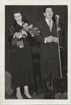 Unidentified Woman with Flowers and Unidentified Man on a Scene