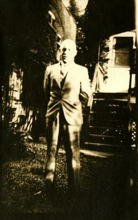 Henry F. Hall Standing in a Front Yard