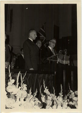 D. B. Clarke presenting Fraser Fulton as Chancellor