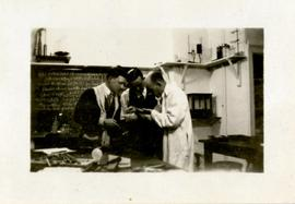 Henry F. Hall and Two Students Working in a Science Lab