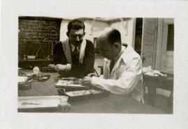 Henry F. Hall and a Student Working in a Science Lab