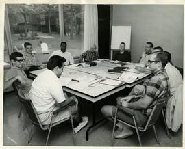 Henry F. Hall Seated with a Group of Students