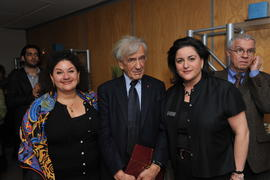 An unidentified person, Elie Wiesel and Naomi Azrieli