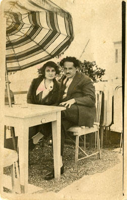 Unidentified Man and Woman Sitting Down