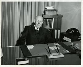 Henry F. Hall in his Office