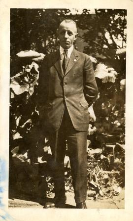 Henry F. Hall in a Suit in a Garden