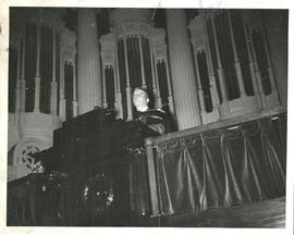 Frederick Owen Stredder in Academic Dress Standing at a Podium