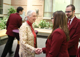 Jane Goodall shaking hand with one Garnet Key Society student