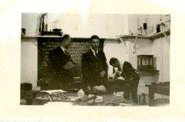 Three Students Working in a Science Lab