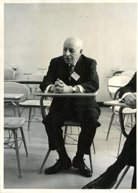 Henry F. Hall at a Students' Desk at Brandon College