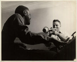 Johnny Holmes and Oscar Peterson rehearsing at the Holmes apartment