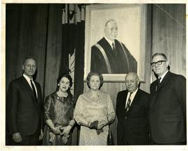 Group Under a Painted Portrait of Owen Stredder