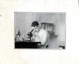Young Man Looking Through a Microscope