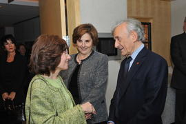 An unidentified person, Judith Woodsworth and Elie Wiesel