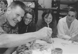 Jean-Pierre Dupuis and students painting ceremics at the West Island Readaptation Centre (WIRC)